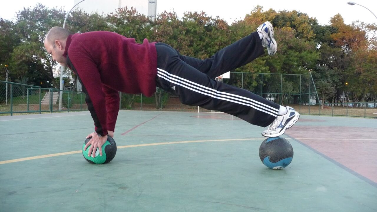 Boost Your Balance-on_two_medicine_balls