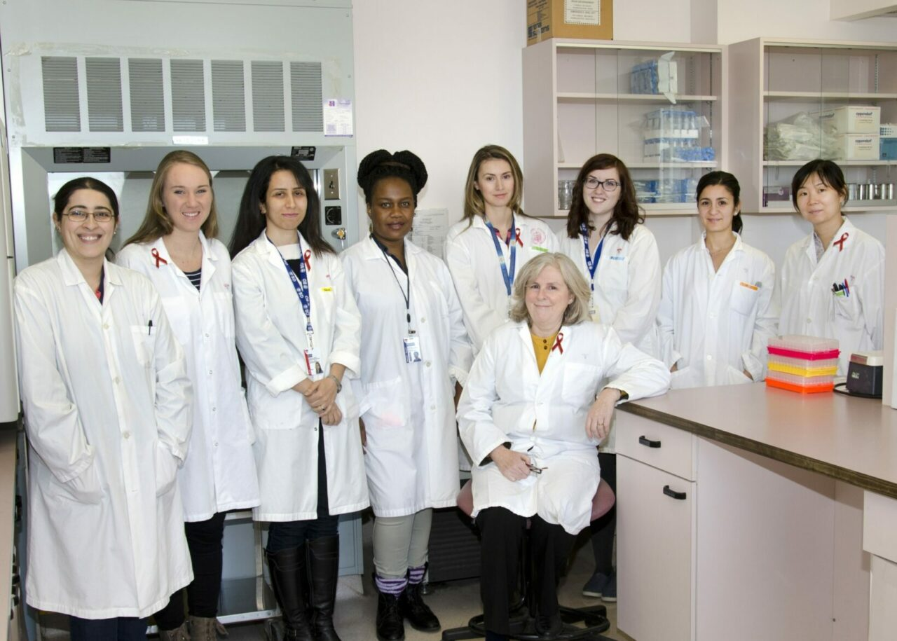 Dr. Nicole Bernard (sitting) and her team from the HIV and Innate Immunity Research Laboratory