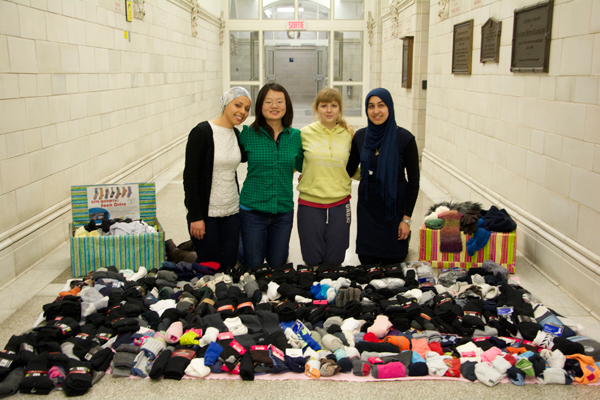 From left to right: Ala Bdira, Jiameng Xu, Sanda Rotari and Saman Ahmad, all members of the Health and Hygiene for Homeless executive, with some of the 518 pairs of socks they collected for Montreal's homeless people. / Photo: Fayeza Ahmad