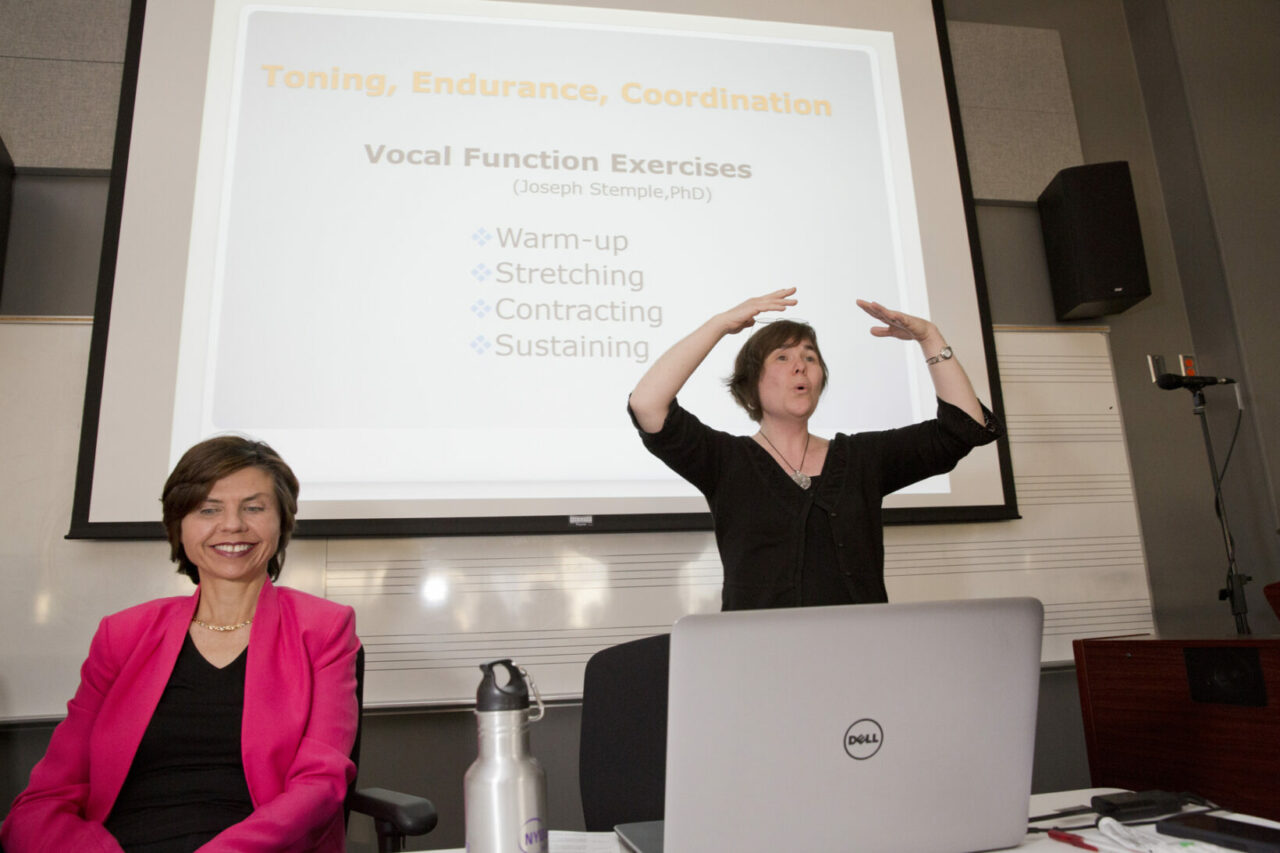 Glenna Waters demonstrating voice exercises prescribed by SLPs. Photo: Nicolas Morin