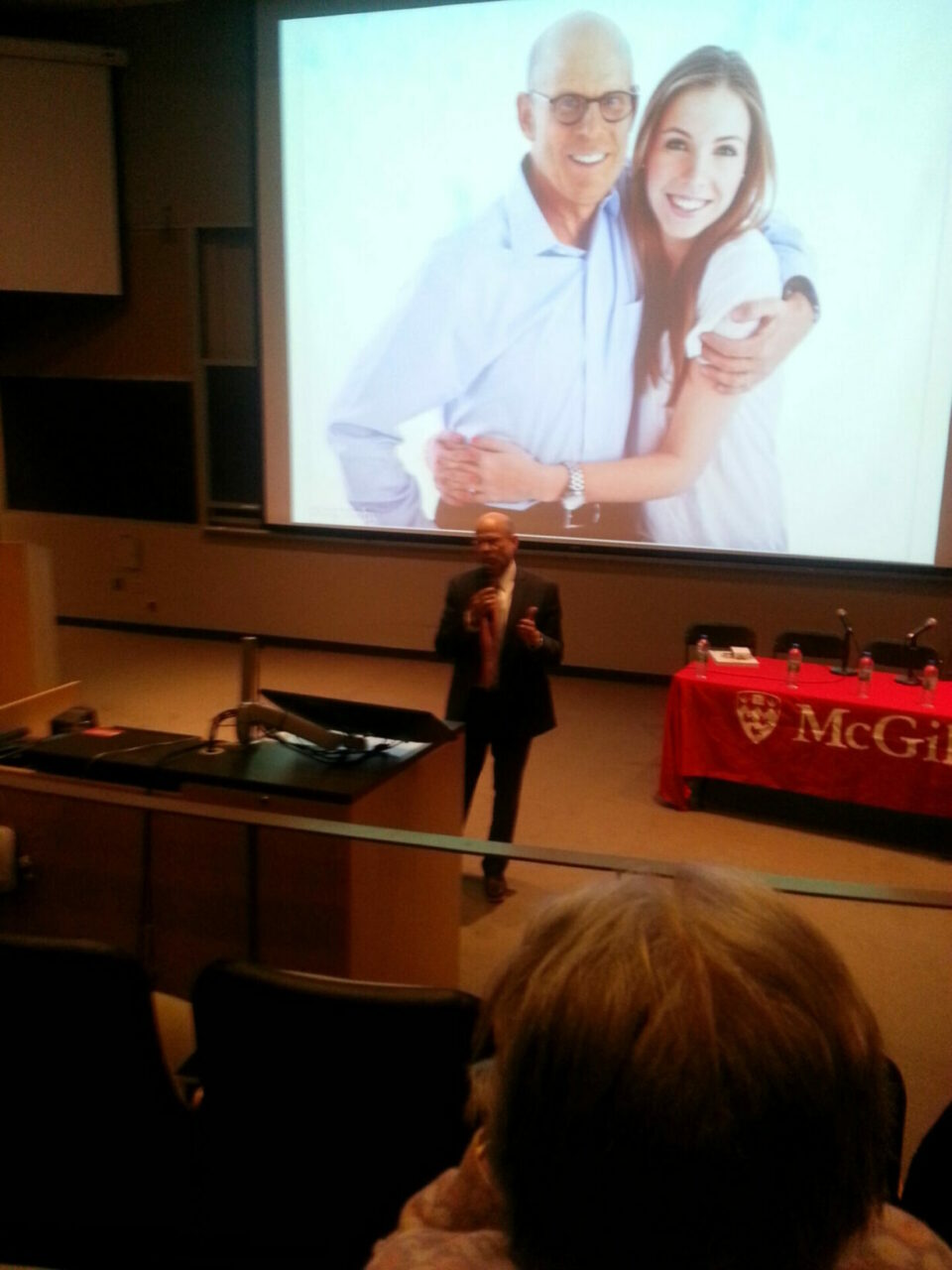 William Brock, BCom'77, BCL'78, LLB'80, closed the evening with an eloquent testimonial, told in six family photos, of how past supporters of cancer research had made it possible for him to see his children, including recent McGill grad, Julianne Brock, BCom'15, into adulthood. Photo: Annette Novak