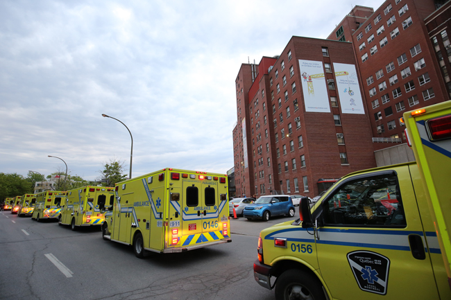 Ambulances line up around the old Children's Hospital.