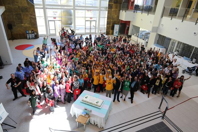 Volunteers celebrate a successful move