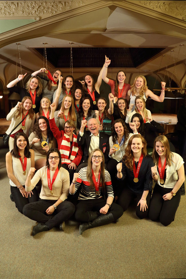 Principal Suzanne Fortier and then-Chancellor Arnold Steinberg celebrate a golden year for the McGill Martlets hockey team in 2014. / Photo: Owen Egan