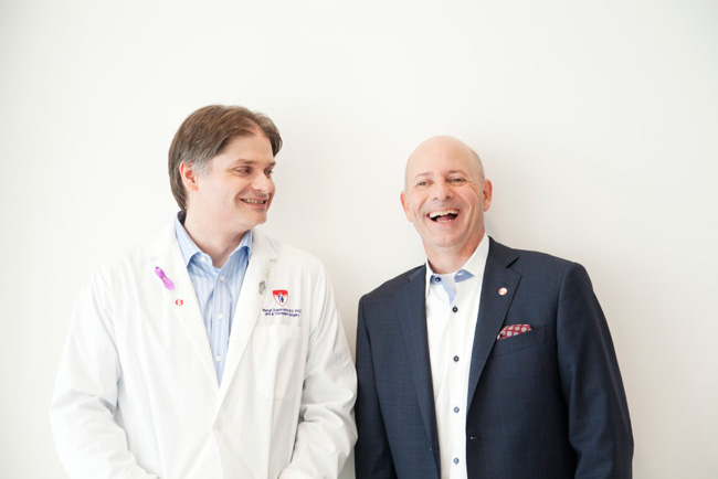Dr. Georges Zogopoulos (left) and Serges Bériault share a happy moment recently. / Photo: Rachel Côté Photographer and to the Cancer Research Society