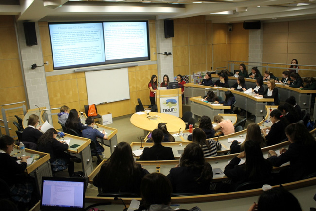 Throughout the day-long event students answer questions on memory, sleep, emotion, perception, stress, aging, brain-imaging, neurology, genetics and brain disease. / Photo: Shawn Hayward