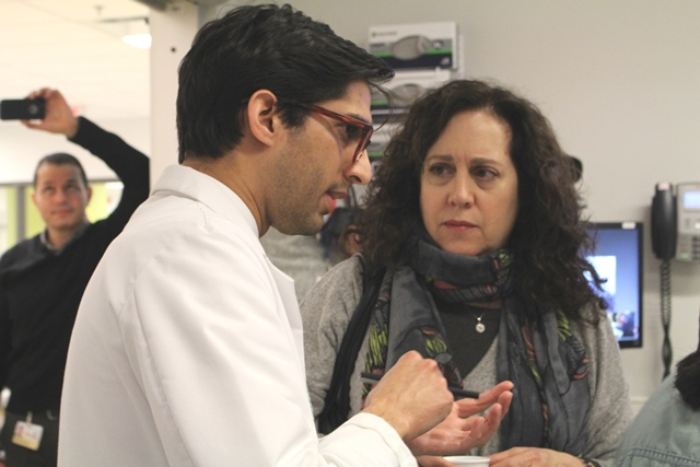 """Dr. Wissanji answers questions from the patient's """"mom""""—an actress who takes part in the entire simulation process."""